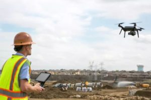 Drone being deployed in to survey & map a construction site.